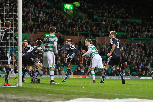 02.03.2016. Celtic Park, Glasgow, Scotland. Scottish Premier League. Celtic versus Dundee. Erik Sviatchenko flashes a header wide challenged by Kostadin Gadzhalov and Kevin Holt