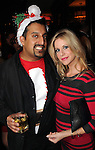 Anand Varadarajan and Hollie Wells at the Christmas themed costume party at Mo's A Place for Steaks Thursday Dec. 20, 2012.(Dave Rossman/For the Chronicle)