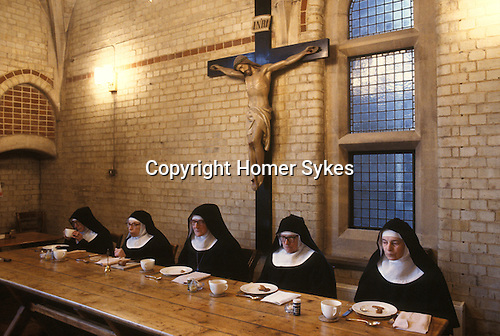 Nuns saying grace before afternoon tea at St Mary at the Cross C of E convent London England UK