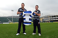 Bath Rugby's new signing Sam Burgess is presented with his shirt by Bath Head Coach Mike Ford during the media session. Bath Rugby Photocall on October 30, 2014 at the Recreation Ground in Bath, England. Photo by: Clare Green for Onside Images