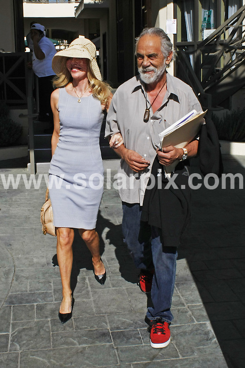 **ALL ROUND PICTURES FROM SOLARPIX.COM**.**WORLDWIDE SYNDICATION RIGHTS**.**NO PUBLICATION IN AUSTRALIA, NEW ZEALAND, DENMARK, GERMANY OR USA**.The American comedy actor famous for the movies Cheech and Chong up in Smoke, Tommy Chong and his wife enjoy lunch on the patio in Brentwood, Los Angeles California in the USA...JOB REF:7929-LAP/CWAS       DATE:17-11-08 .**MUST CREDIT SOLARPIX.COM OR DOUBLE FEE WILL BE CHARGED* *UNDER NO CIRCUMSTANCES IS THIS IMAGE TO BE REPRODUCED FOR ANY ONLINE EDITION WITHOUT PRIOR PERMISSION*