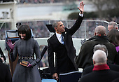 United States President Barack Obama waves after being sworn in by Supreme Court Chief Justice John Roberts as First lady Michelle Obama looks on during the public ceremonial inauguration on the West Front of the U.S. Capitol January 21, 2013 in Washington, DC.   Barack Obama was re-elected for a second term as President of the United States.  .Credit: Win McNamee / Pool via CNP