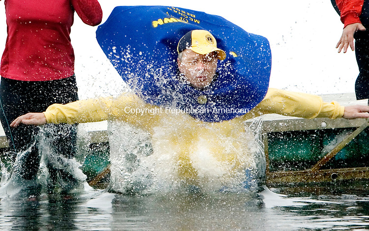 WATERTOWN CT. 15 February 2014-021514SV13-Joel Labonte of Watertown takes the plunge during the first Polar Plunge at YMCA's Camp Mataucha in Watertown Saturday.<br /> Steven Valenti Republican-American