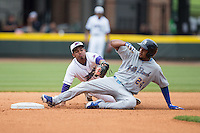 Jeimer Candelario (24) of the Myrtle Beach Pelicans slides into second base ahead of the tag attempt by Cleuluis Rondon (5) of the Winston-Salem Dash at BB&T Ballpark on April 18, 2015 in Winston-Salem, North Carolina.  The Pelicans defeated the Dash 4-1 in game one of a double-header.  (Brian Westerholt/Four Seam Images)