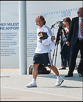 BNPS.co.uk (01202 558833)<br /> Pic: PhilYeomans/BNPS<br /> <br /> Modric emerges from the terminal building.<br /> <br /> Footballing aristocrats Real Madrid flew into the unlikely enviroment of Bournemouth today for a much anticipated friendly against the seaside town's football team.<br /> <br /> Despite fears that their second team would turn up excited fans at the airport couldn't beleive their eyes when Ancelotti led out Ronaldo, Zidane, Kaka, Modric and many more stars from the terminal building.