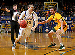BROOKINGS, SD - JANUARY 22: Alex Arians #34 of the South Dakota State Jackrabbits looks to drive against <br /> Jared Samuelson #11 of the North Dakota State Bison at Frost Arena on January 22, 2020 in Brookings, South Dakota. (Photo by Dave Eggen/Inertia)