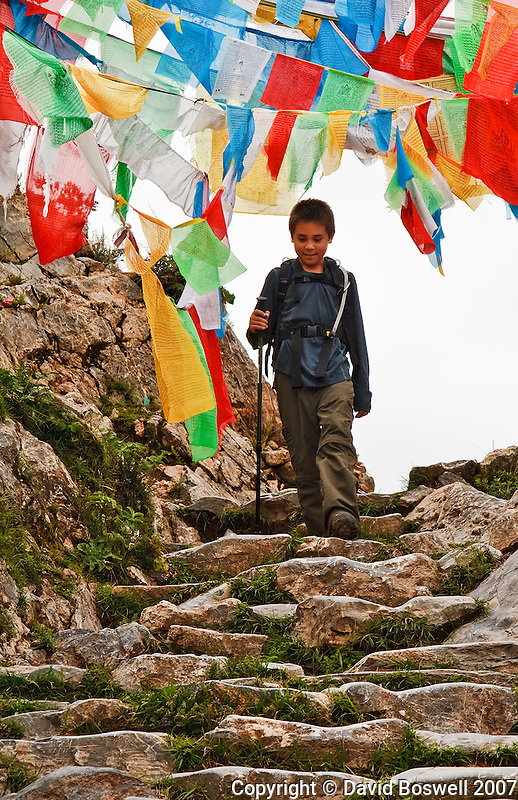 My son Ethan, 13, hiking the kora at Ganden Monastery near Lhasa, Tibet.  Ganden sits at ~15,000 ft. elevation.