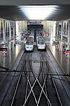 Two RENFE Alvia trains at platform of Atocha railway station, Madrid, Spain