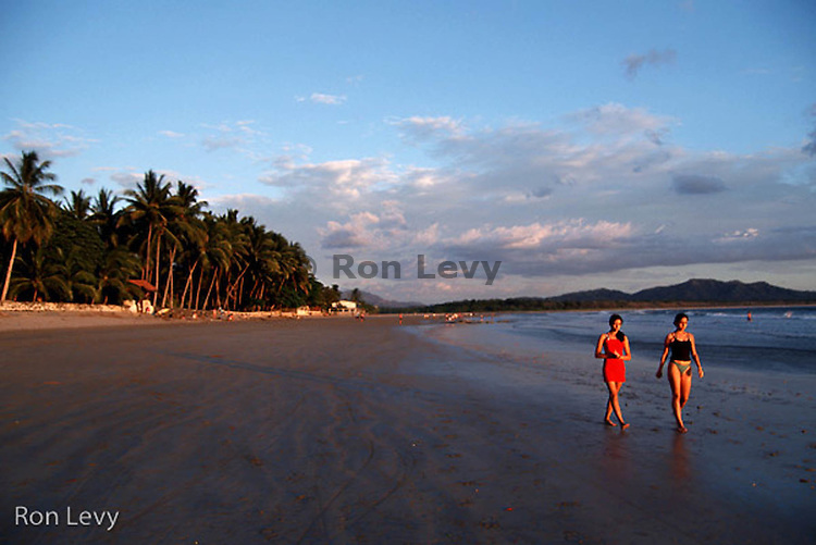 Girls on beach at sunset, Nicoya Peninsula, Costa Rica