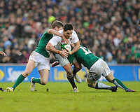 Brad Barritt of England is tackled by Ronan O'Gara (left) and Gordon D'Arcy of Ireland during the RBS 6 Nations match between Ireland and England at the Aviva Stadium, Dublin on Sunday 10 February 2013 (Photo by Rob Munro)