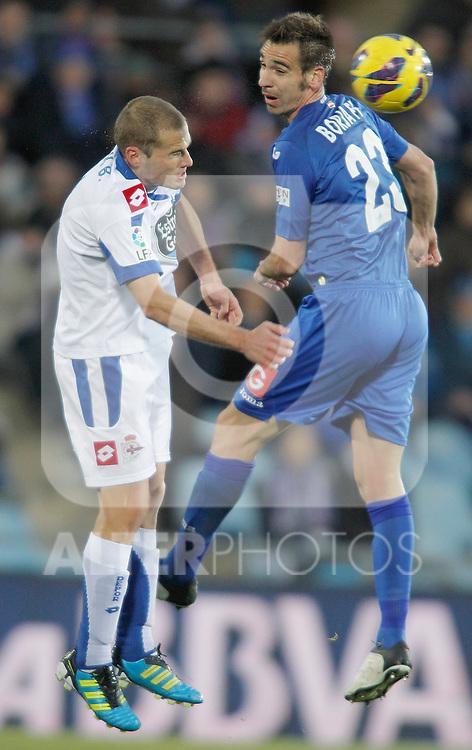 Getafe's Borja Fernandez against Deportivo de La Coruna's Alejandro Bergantinos during La Liga match. February 01, 2013. (ALTERPHOTOS/Alvaro Hernandez)