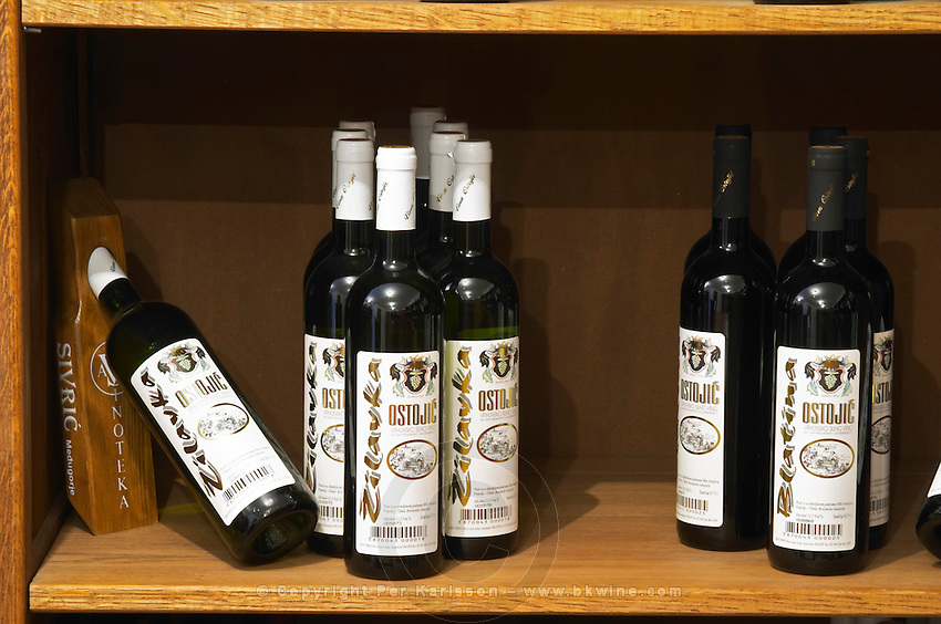 In the winery wine shop, display of various wines from the Ostojic winery Podrum Vinoteka Sivric winery, Citluk, near Mostar. Federation Bosne i Hercegovine. Bosnia Herzegovina, Europe.