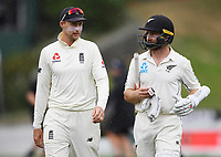 3rd December, Hamilton, New Zealand;  England captain Joe Root and New Zealand captain Kane Williamson chat as they leave the field for rain day 5 of the 2nd test cricket match between New Zealand and England at Seddon Park, Hamilton, New Zealand.
