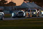 The No. 2 Audi (and eventual race winner) in traffic as the sun sets during the 2012 12 Hours of Sebring.