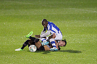 Callum O'Hare of Aston Villa  goes in hard on Kyel Reid of Colchester United and gets booked during Colchester United vs Aston Villa, Caraboa Cup Football at the Weston Homes Community Stadium on 9th August 2017