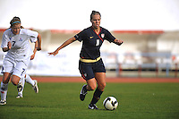 US Forward Lauren Cheney dribbles against Iceland at a 2010 Algarve Cup game in Vila Real Sto. Antonio, Portugal.