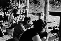 Switzerland. Canton Bern. Brienz. A group of women and men are firing their rifles at Schiessstand (Shooting range) Engi during the 2016 Brienzer Jagdschiesssen (Hunter shooting competition days). 30.07.2016  © 2016 Didier Ruef