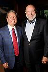 Roland Garcia and Bob Cavnar at the Recipe for Success' Delicious Alchemy Dinner at the home of Becca Cason Thrash Wednesday April 19,2017.(Dave Rossman Photo)
