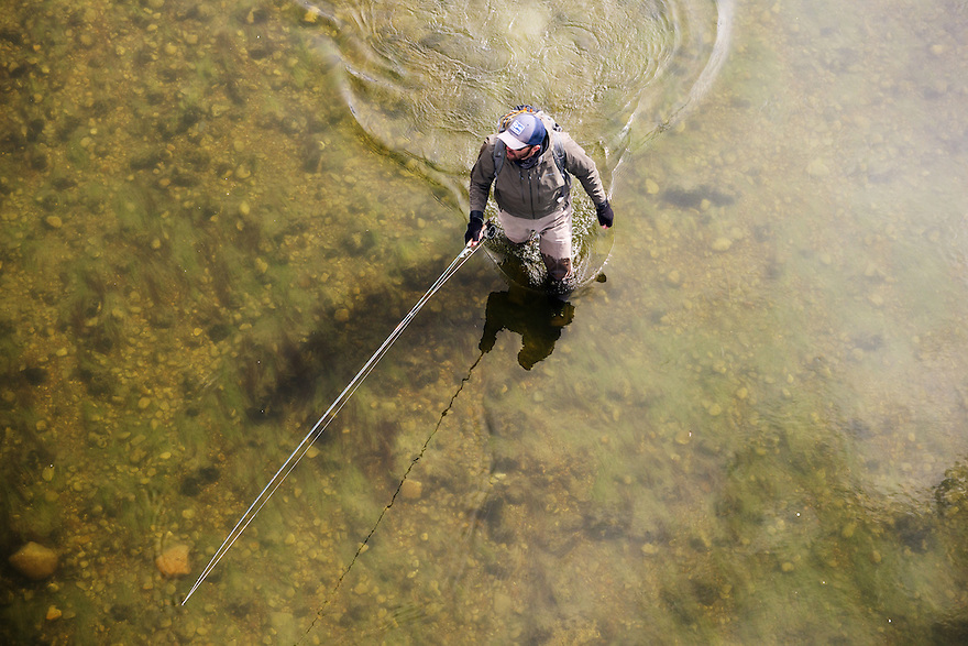 An angler wades a river in northern Montana.