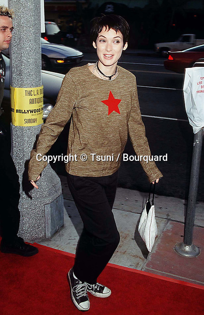 Winona Ryder arriving  at the premiere of Free Tibet at the Century Plaza Theatre in Los Angeles.  September 9, 1998.