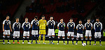 Scotland players line up for a minutes silence during the Vauxhall International Challenge Match match at Hampden Park Stadium. Photo credit should read: Simon Bellis/Sportimage