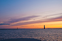 Frankfort Lighthouse is silhouetted at sunset on Lake Michigan, Benzie County, Michigan
