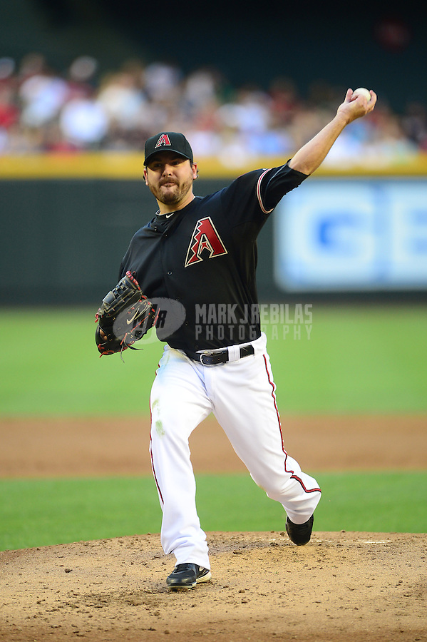 Apr. 21, 2012; Phoenix, AZ, USA; Arizona Diamondbacks pitcher Joe Saunders throws in the second inning against the Atlanta Braves at Chase Field. Mandatory Credit: Mark J. Rebilas-