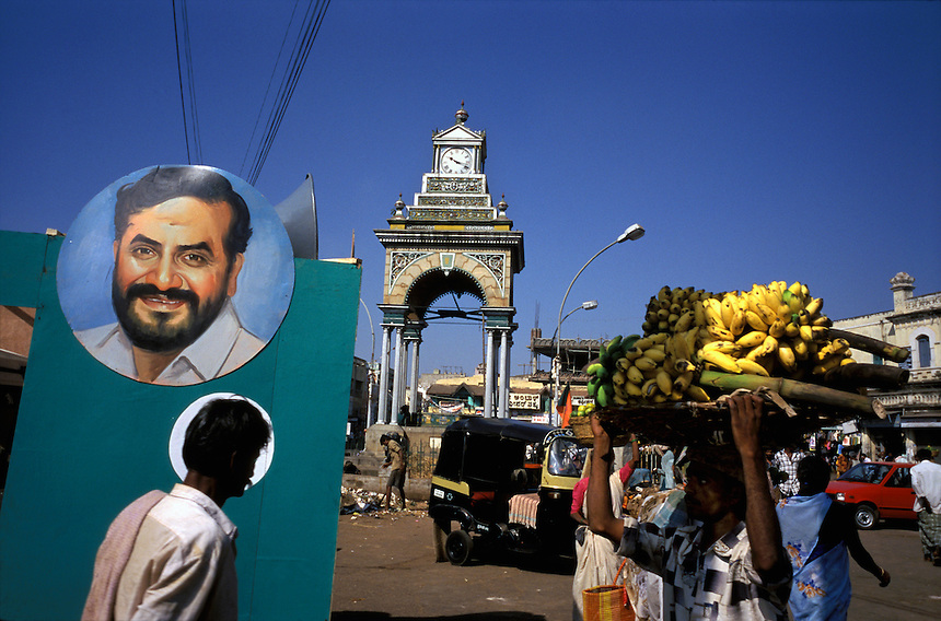 Pedestrians and vendors pass political posters in a central square in Mysore, India, shortly before the 1998 elections. Voting in the world's largest democracy resulted in a 17-party coalition government.