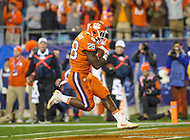 Charlotte, NC - December 2, 2017: Clemson Tigers running back Tavien Feaster (28) scores a touchdown during the ACC championship game between Miami and Clemson at Bank of America Stadium in Charlotte, NC. Clemson defeated Miami 38-3 for their third consecutive championship title. (Photo by Elliott Brown/Media Images International)