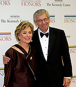 United States Senator Barbara Boxer (Democrat of California) and her husband, Stewart, arrive for the formal Artist's Dinner honoring the recipients of the 2012 Kennedy Center Honors hosted by United States Secretary of State Hillary Rodham Clinton at the U.S. Department of State in Washington, D.C. on Saturday, December 1, 2012. The 2012 honorees are Buddy Guy, actor Dustin Hoffman, late-night host David Letterman, dancer Natalia Makarova, and the British rock band Led Zeppelin (Robert Plant, Jimmy Page, and John Paul Jones)..Credit: Ron Sachs / CNP
