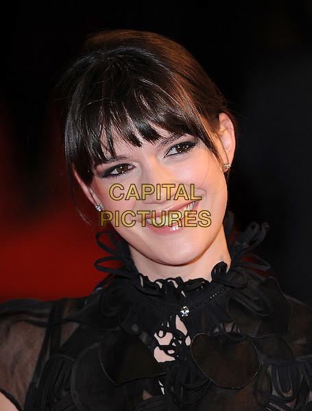 MEGAN MACZKO.'Me & Orson Welles' UK film premiere at the Vue West End, Leicester Sqaure, London, England.November 18th, 2009.headshot portrait black bangs fringe smiling sheer see through thru collar high neck ruffles ruffle .CAP/BEL.©Tom Belcher/Capital Pictures.