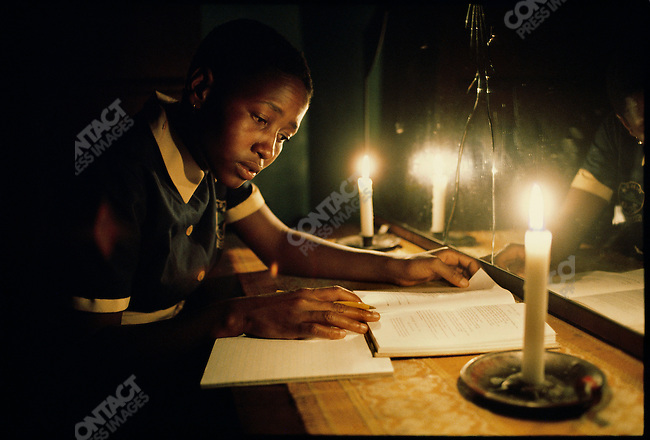 Homework by candlelight, Soweto, South Africa, March, 1976.