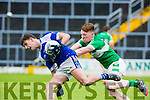 Jack Savage KOR powers past Darragh Doherty Legion during their SFC clash in Fitzgerald Stadium on Sunday