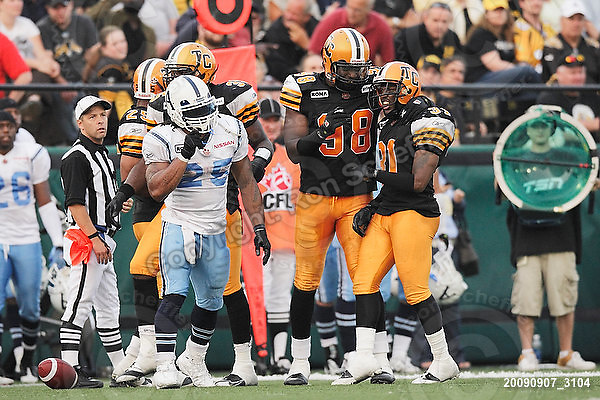September 7, 2009; Hamilton, ON, CAN; Hamilton Tiger-Cats defensive back Jykine Bradley (31) is congratulated by teammates on his tackle of Toronto Argonauts running back Jamal Robertson (25). CFL football - the Labour Day Classic - Toronto Argonauts vs. Hamilton Tiger-Cats at Ivor Wynne Stadium. The Tiger-Cats defeated the Argos 34-15. Mandatory Credit: Ron Scheffler.