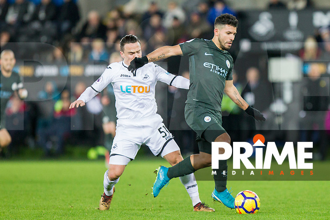 Sergio Aguero of Manchester City gets past Roque Mesa of Swansea City during the EPL - Premier League match between Swansea City and Manchester City at the Liberty Stadium, Swansea, Wales on 13 December 2017. Photo by Mark  Hawkins / PRiME Media Images.