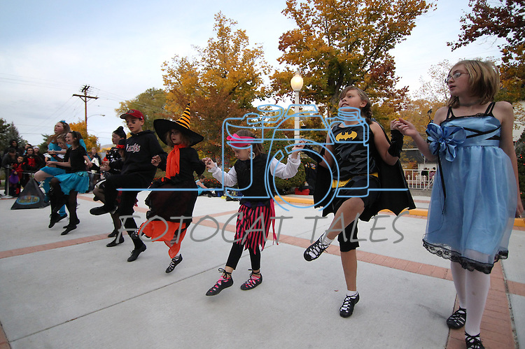 Dancers with the Carson City Dance Troupe entertain trick-or-treaters at the Governor's Mansion in Carson City, Nev. on Wednesday, Oct. 31, 2012. An estimated 300 pounds of donated candy will be handed out to thousands of local kids..Photo by Cathleen Allison