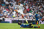 Real Madrid's player Mariano Diaz Mejia and Celta de Vigo's player Pape during a match of La Liga Santander at Santiago Bernabeu Stadium in Madrid. August 27, Spain. 2016. (ALTERPHOTOS/BorjaB.Hojas)