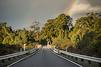Road with bridge over Waita river and rainbow, West Coast, South Westland, South Island, New Zealand