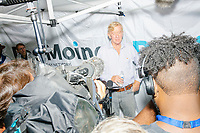 Former Mass. governor Bill Weld, a Republican presidential candidate, speaks to the media on a rainy day at the Iowa State Fair in Des, Moines, Iowa, on Sun., Aug. 11, 2019.