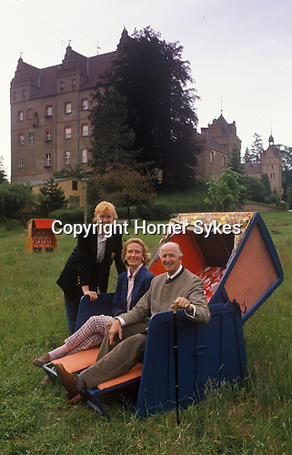 Count Adolf-Heinrich Graf von Arnim / Adolf-Heinrich Count von Arnim-Boitzenburg seen here with his wife Angelica Gräfin von Arnim  and daughter in 1990 returns to the family estate and Boitzenburg castle for the first time, to claim back his inheritance from East Germany government. The castle is being used by the DDR as a sanatorium and vacation resort for officers and retired officers and their families of the East German Army.