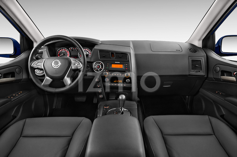 Stock photo of straight dashboard view of2014 Ssangyong Actyon Sports Quartz 4 Door Pick Up Dashboard
