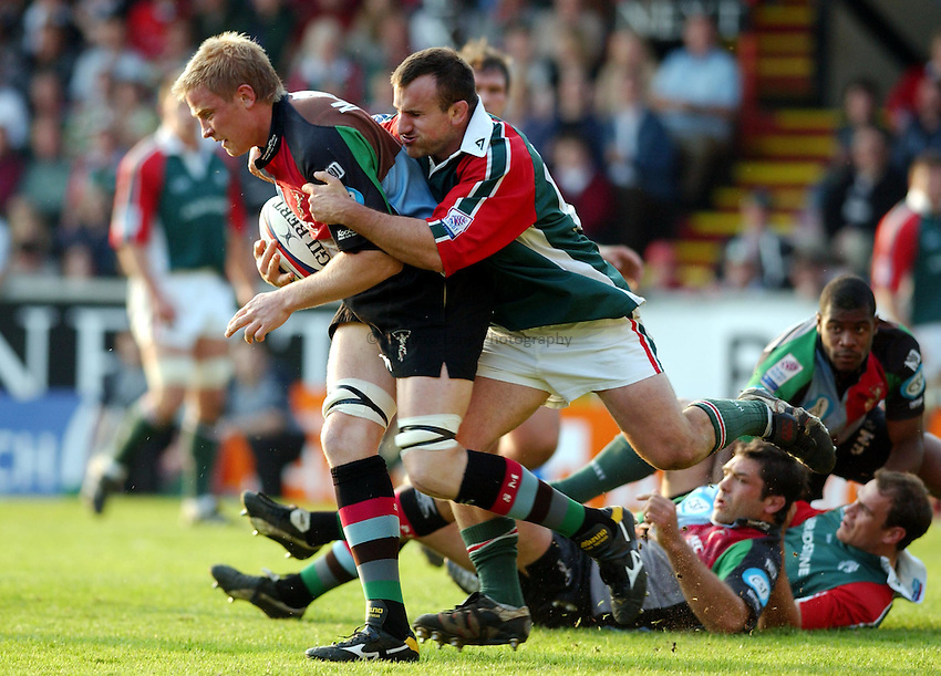 Photo. Dan Hanbury..Leicester Tigers v NEC Harlequins. Zurich Premiership. 15/05/2004..Simon Miall is held by George Chuter.