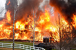 A massive fire consumes a large home on Barber Hill Road that completely  destroyed the home, Thursday evening, April 11, 2019, in East Windsor. (Jim Michaud / Journal Inquirer)