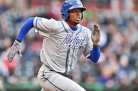 Hartford Yard Goats left fielder Rosell Herrera (7) runs to first during a game against the Richmond Flying Squirrels at The Diamond on April 30, 2016 in Richmond, Virginia. The Yard Goats defeated the Flying Squirrels 5-1. (Tony Farlow/Four Seam Images)