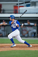 Brandon Thomasson (66) of the Burlington Royals follows through on his swing against the Danville Braves at Burlington Athletic Park on July 12, 2015 in Burlington, North Carolina.  The Royals defeated the Braves 9-3. (Brian Westerholt/Four Seam Images)