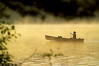 Algonquin Park, Ontario, Canada, July 2006. Early morning sun burns of the fog on the North Arm of Opeongo lake. The Algonquin Provincial Park consists of many lakes that can be explored by canoe and which are connected by portages. Photo by Frits Meyst/Adventure4ever.com