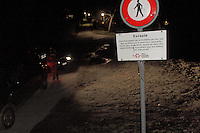 Night patrol by the Swiss Corps of the Gardes Frontière on the border between Switzerland and France in Geneva province..Swiss traffic signs forbidding human crossing, except during the day with international identity document and with less then customs tolerate goods.