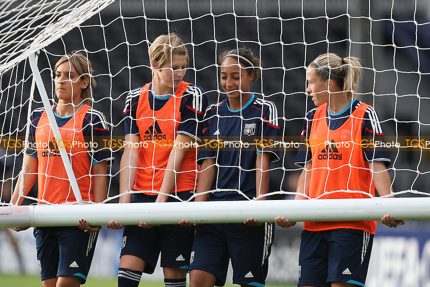 Olympique Lyonnais players train on the Craven Cottage pitch ahead of the UEFA Women's Champions League Final at Fulham FC - 25/05/11 - MANDATORY CREDIT: Gavin Ellis/TGSPHOTO - Self billing applies where appropriate - Tel: 0845 094 6026