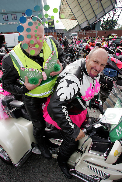 Two of the lads get set for the bike run  Martin Murray and Don Laidlaw .Killie Bikers go on a run for Cancer Charity bike run leaving from Rugby Park. .120 bikers in pink bras and vests are setting off on a four-day ride around Scotland. The male bikers will all be wearing specially decorated bras over their leathers along with feather boas and wigs. The women will be wearing pink high visibility vests and helmet sporting pink mohawks during the ride.  .Picture: Alistair Mulhearn/Universal News And Sport (Scotland). 1 June 2012
