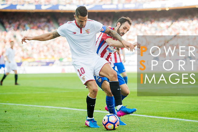 Juan Francisco Torres Belen, Juanfran (r), of Atletico de Madrid battles for the ball with Victor Machin Perez, Vitolo, of Sevilla FC during their La Liga match between Atletico de Madrid and Sevilla FC at the Estadio Vicente Calderon on 19 March 2017 in Madrid, Spain. Photo by Diego Gonzalez Souto / Power Sport Images